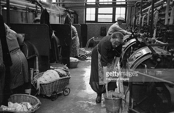 Glaswegians bring their laundry to the Corporation washhouse which costs fourpence an hour Many Glaswegian housewives do their laundry at a municipal...