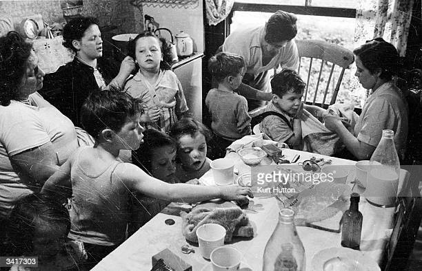 Some of the twenty children of recordbreaking mother Elizabeth Hudson crowding into the kitchen of their London home Original Publication Picture...