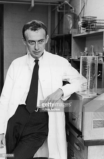 American biochemist Dr James Dewey Watson stands in his lab next to a model of the molecular structure of DNA