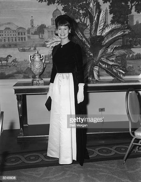American heiress, actor, artist and designer Gloria Vanderbilt poses in a velvet and taffeta evening gown at the Girls Town Ball.