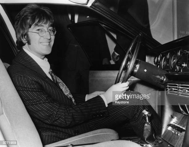 A happy John Lennon at the wheel of the ISO Rivolta S4 car which he bought for £6150 at the preview of the Motor Show