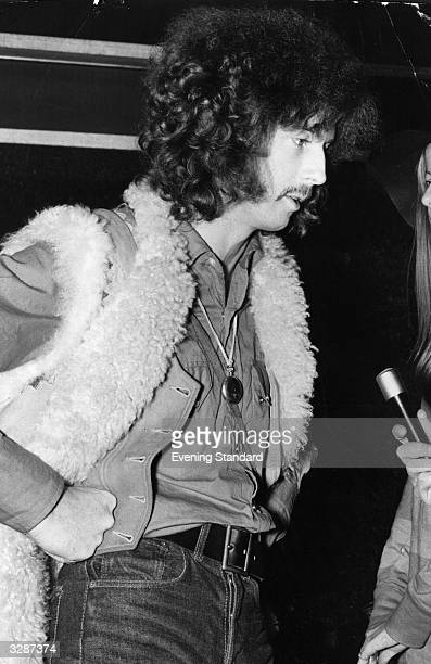 British bluesrock guitarist Eric Clapton of the rock group Cream being interviewed at Los Angeles Airport October 1967
