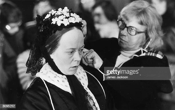 Scottish actress Annette Crosbie having the final touches of her makeup applied for her role as Queen Victoria