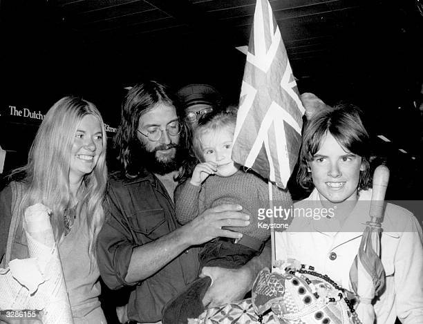 Doug Scott, a member of the British team which scaled Mount Everest, on his arrival at Heathrow Airport with his family.