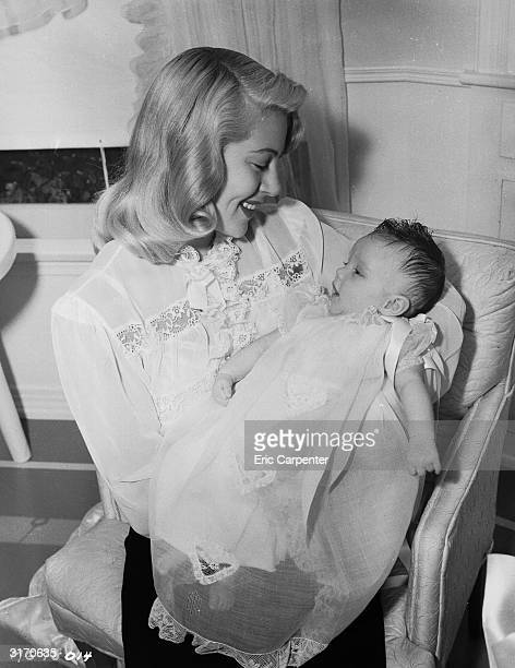 Hollywood actress Lana Turner cradles her new born daughter Cheryl Crane In 1958 Cheryl would be tried for the murder of her mother's boyfriend...