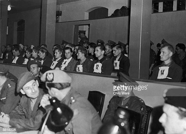 Prisoners from amongst the guards of the Belsen concentration camp, photographed in the dock during the 'Beast of Belsen' trial, at Luneburg.