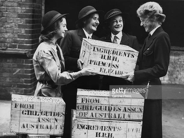 Miss Anderton general secretary of Imperial headquarters receiving a gift of ingredients for Princess Elizabeth's wedding cake at Guide headquarters...