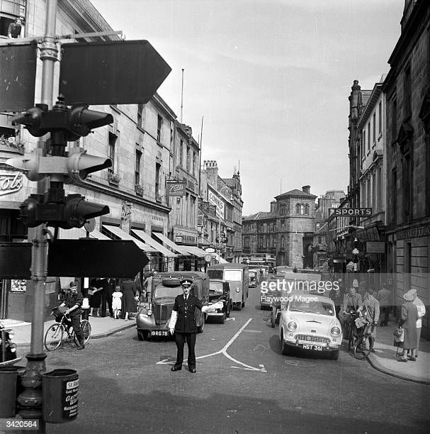 A policeman on traffic duty directs cars at a busy junction in Inverness The city's good road and rail links enabled it to flourish as a tourist...