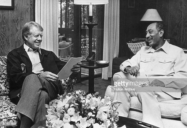 US president Jimmy Carter and Egyptian president Anwar alSadat sitting in Dogwood Lodge during a break in the Egypt Israel peace agreements at Camp...