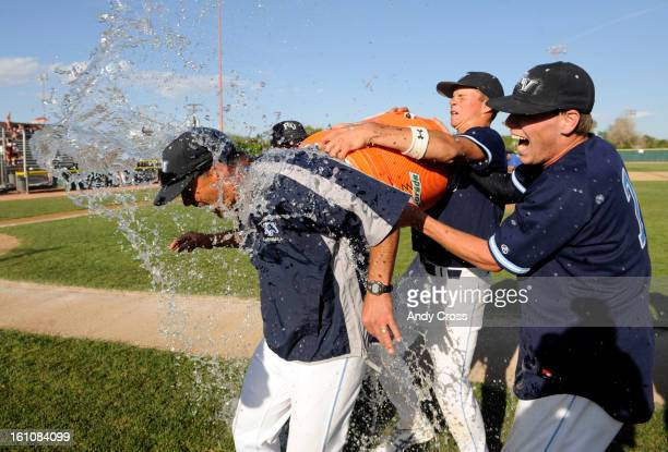 DENVER COLORADOMAY 17TH2008Ralston Valley teammates from left to right Ryan Barban Conner Knutson and Travis Hayes douse coach Shane Freehling after...