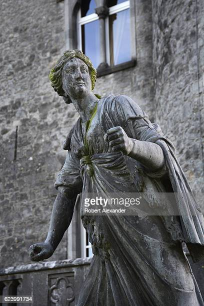 A 17thcentury lead statue of Diana in Roman mythology the goddess of the hunt the moon and birthing stands beside the 12thcentury Kilkenny Castle in...