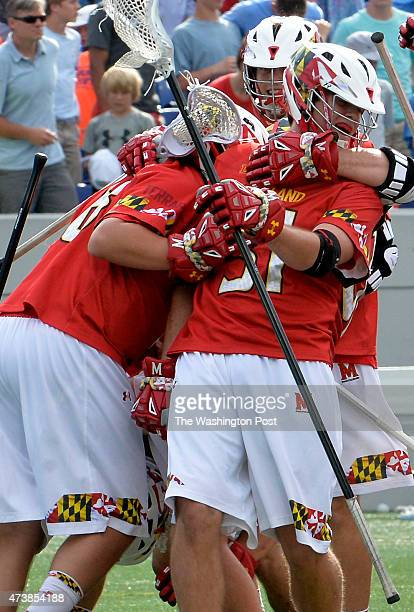 University of Maryland players celebrate the 14 07 victory over North Carolina in the NCAA quarterfinal game at Navy Marine Corps Memorial Stadium on...