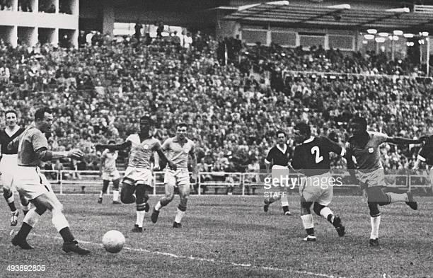 17yearold Brazilian forward Pele kicks the ball past Welsh goalkeeper Jack Kelsey during the World Cup quarterfinal soccer match between Brazil and...