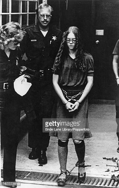 17yearold Brenda Ann Spencer leaves the courthouse in Santa Ana California escorted by sheriff's deputies after pleading guilty to two counts of...