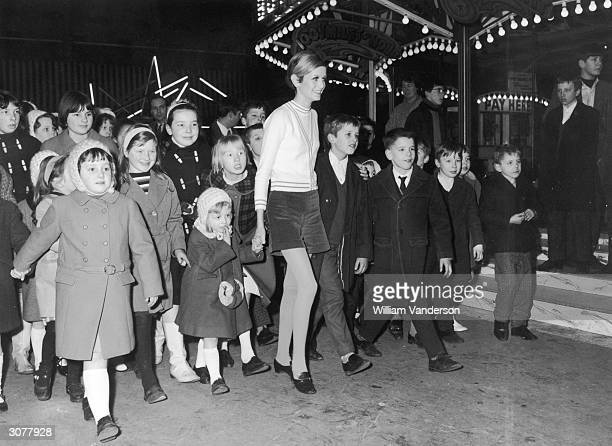 17yearold British fashion model Twiggy takes a group of children from the Lambeth Mission to the Bertram Mills Circus at Olympia 5th January 1967 The...