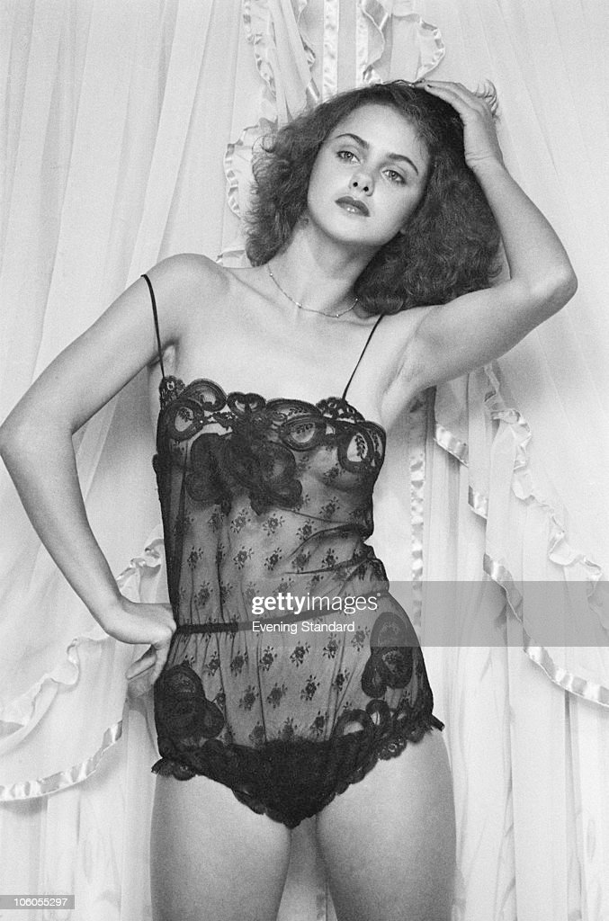 4a63342c14 17-year-old Debbie Brett models a black lace teddy by Janet Reger at ...