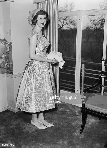 17yearold debutante Melanie Lowson the daughter of former Lord Mayor of London Denys Lowson prepares to leave her London flat for a garden party at...
