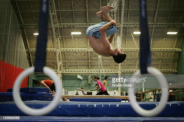 17yearold Emmett VorspanStein practices backflips while Abbie Green leads a Cambridge Community Gymnastics class at MIT's duPont Gymnasium Many of...