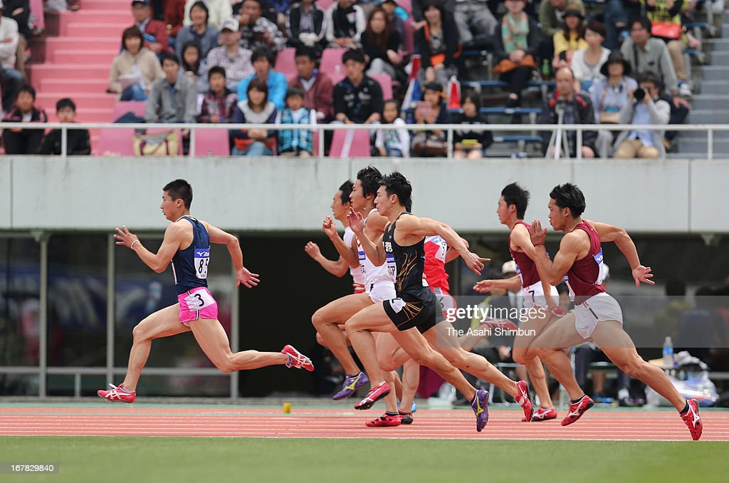 17-year-old high school student Yoshihide Kiryu (L) competes in the Men's 100m qualification during the Mikio Oda Memorial Athletics Championships at Edion Stadium Hiroshima on April 29, 2013 in Hiroshima, Japan.