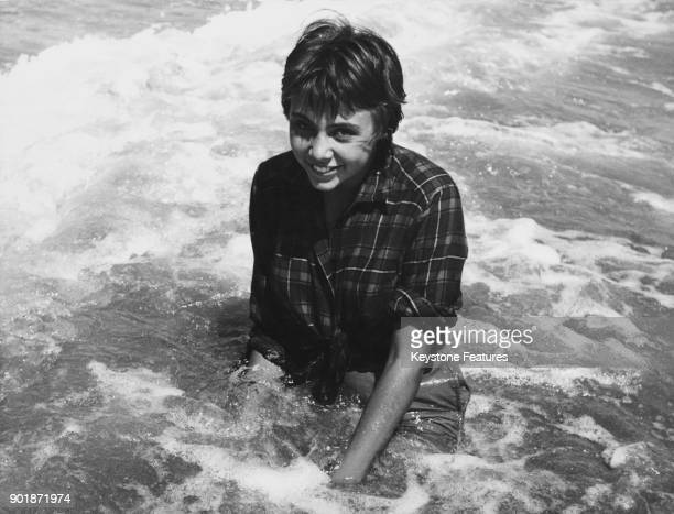 17yearold Italian actress Patrizia Bini splashes in the sea at Venice Italy during the Venice Film Festival 31st August 1957