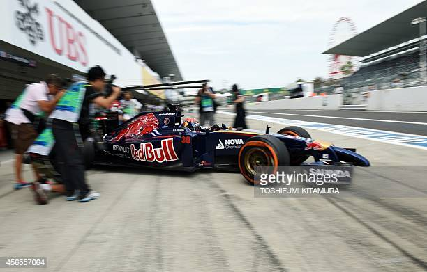 17yearold Toro Rosso driver Max Verstappen of Netherlands leaves his pit during the first practice session at the Formula One Japanese Grand Prix in...
