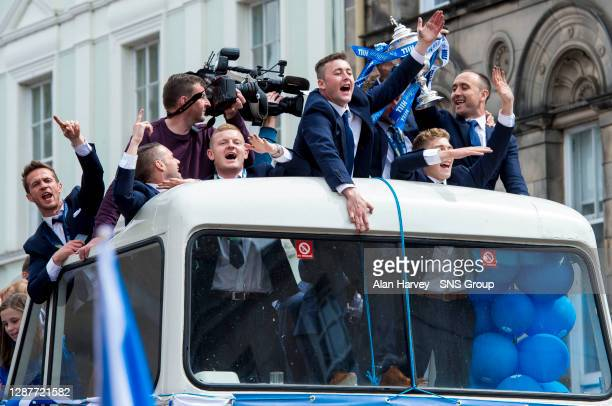 Brian Easton, Thomas Scobbie, David Wotherspoon and Lee Croft lead the St Johnstone celebrations on the open top bus.