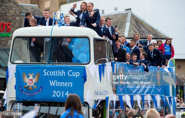 Brian Easton, Thomas Scobbie, David Wotherspoon, Stevie May, Lee Croft and Steven Anderson lead the St Johnstone celebrations on the open top bus.