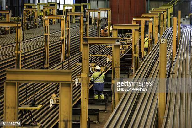 180ft long sections of steel are laid out ready for transport on trains at the British Steel Scunthorpe plant in north Lincolnshire north east...