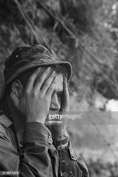 1/8/66Pleiku South Vietnam A boneweary soldier holds his head in his hands and stares sighlessly into space after completing 'Operation Maurader' Jan...