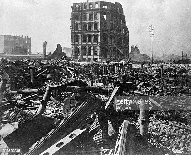 Looking across the ruins of the Field Leiter and Co store toward the standing walls of the First National Bank at State an Washington Streets