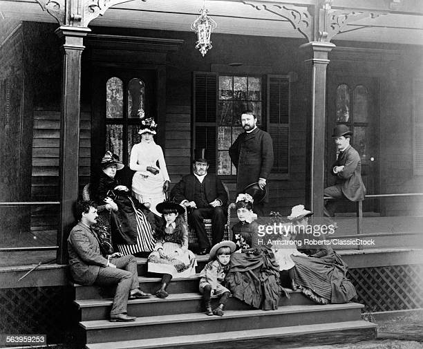 1880s 1886 19TH CENTURY PRESIDENT GENERAL ULYSSES S GRANT EXTENDED FAMILY GROUP ON FRONT PORCH MOUNT McGREGOR NEW YORK USA