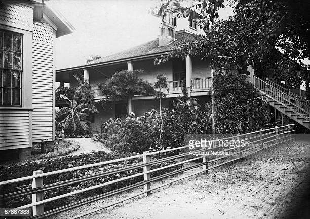 A side view of the clubhouse when it was used as a residence by the Berckmans family showing their many plantings at Fruitland Nurseries later to...