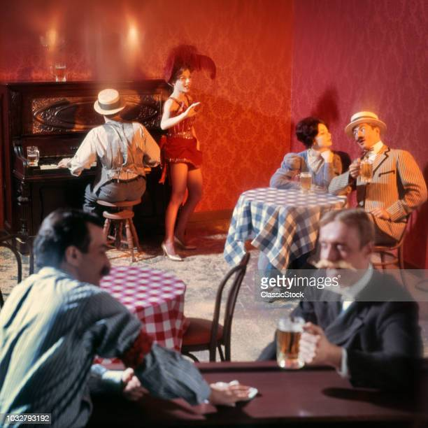 1890s TURN OF THE 20TH CENTURY BAR BEER PARLOR WITH RAGTIME PIANO PLAYER SALOON SINGER AND PATRONS