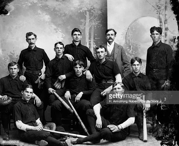 1890s TURN OF THE 20TH CENTURY BASEBALL TEAM PORTRAIT PLAYERS HOLDING BATS MITTS LOOKING AT CAMERA