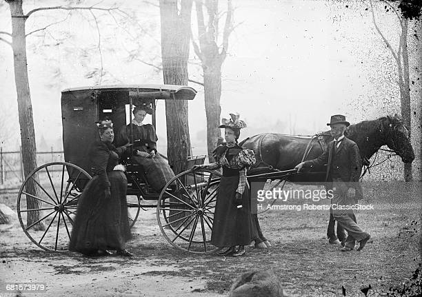 1890s WOMAN SITTING IN...
