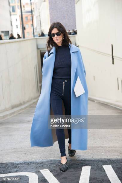 Fashion blogger Hedvig Opshaug wears a Holzveiler coat Versace trousers Celine shoes Prada bag and RayBan sunglasses on day 4 of London Womens...