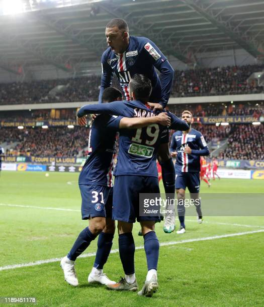 Pablo Sarabia of Paris Saint-Germain celebrates his goal with Kylian Mbappe and teammattes during the Ligue Cup match between Le Mans FC and Paris...