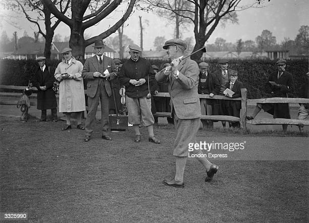 Golfer Abe Mitchell driving off from the first tee in the Annual Professional Invitation Golf competition held at Roehampton His opponent Tom...