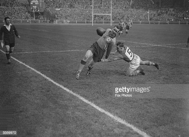 A Warrington player fails to bring down his opponent during the Rugby League Cup Final between Leeds and Warrington at Wembley Stadium London