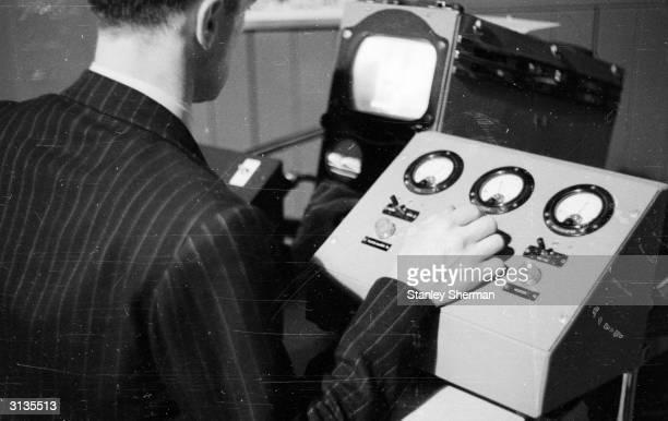 Remote control operator controlling a Marconi underwater television camera.
