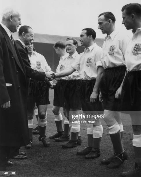 The captain of the England football team Billy Wright introducing Lord Alexander to members of the team including Alf Ramsey and Tom Finney