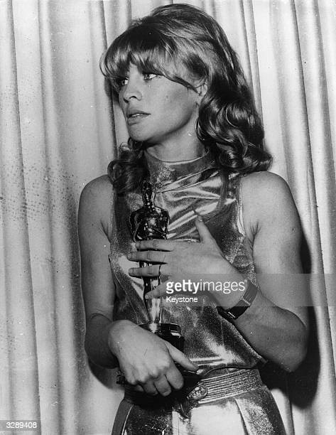 British actress Julie Christie holds the Academy Award she won for her role in the film 'Darling' at the awards reception at the Civic Auditorium at...