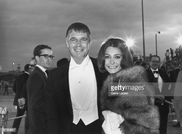 EXCLUSIVE Married American actors George Peppard and Elizabeth Ashley smile as they arrive at the Academy Awards Santa Monica California Ashley wears...