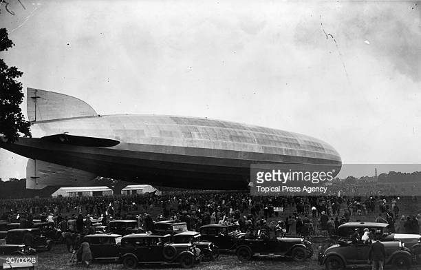 Crowds gather at Hanworth Park Middlesex to witness the landing of the massive German Graf Zeppelin German tourists disembarked from the aircraft and...