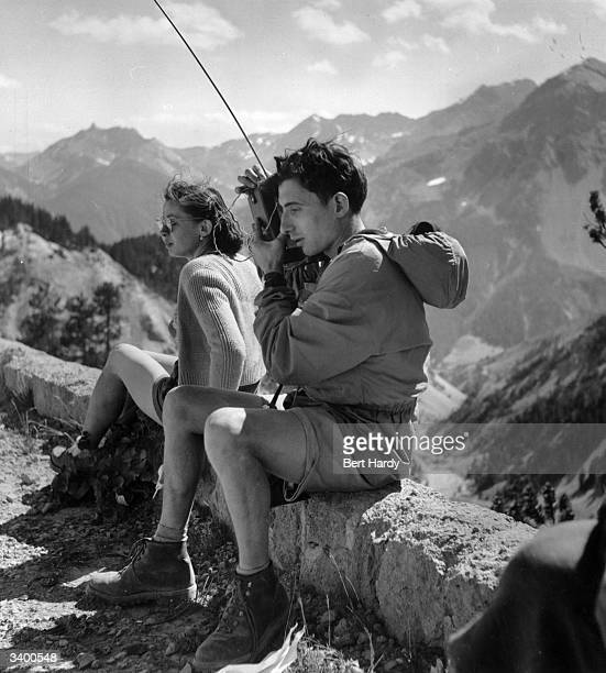 A race official keeps in touch with others via walkietalkie along the route of the 1951 Tour de France Original Publication Picture Post 5381 The...