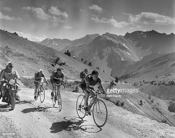 Cyclists competing in the Tour de France riding through the French Alps Original Publication Picture Post 5381 The Greatest Show On Earth pub 1951