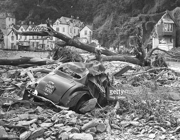 Lying crushed among the trees and rubble is one of the many cars swept away by the flooding at Lynmouth