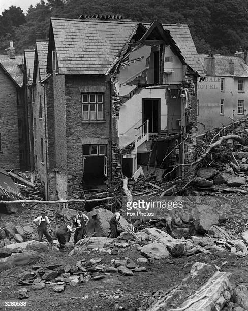 Rescue workers look for bodies of missing people at Lynmouth Devon following floods