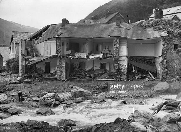 The river Lyn East and West caused enormous damage as well as killing 31 people in North Devon here it tore the front off a family house at Lynmouth