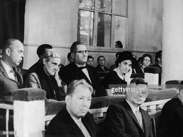 Francis Gary Powers the American U2 spy plane pilot on trial in Russia on charges of espionage This picture shows his parents in court with his wife...